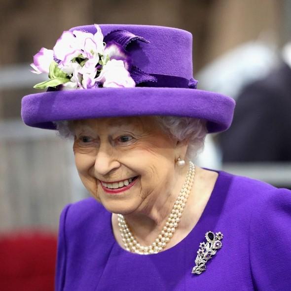 The Queen wearing purple