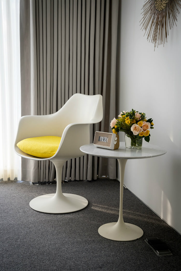 Closeup of mid-century modern chair and side table