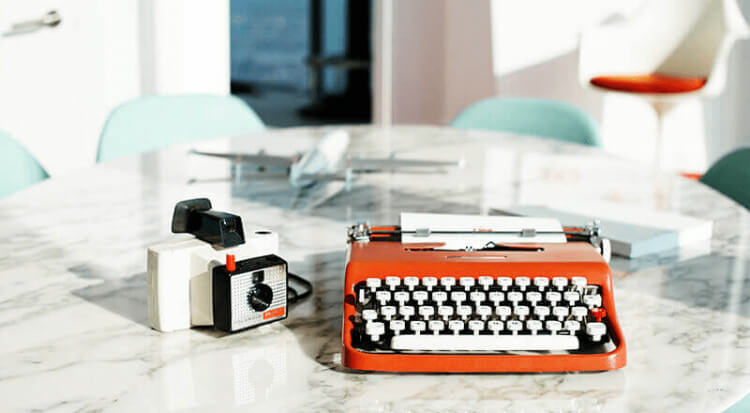 Polaroid camera and Olivetti typewriter in TWA Lounge