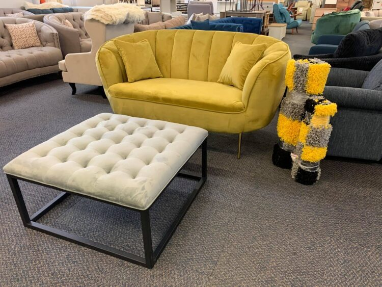 Yellow loveseat sofa and large Grey footstool